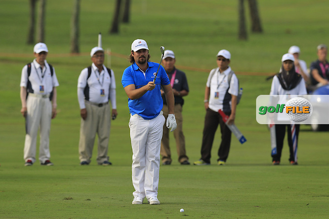 Victor Dubuisson (FRA) Team Europe prepares to play his 2nd shot on the 1st hole during Match 1 of Friday's Fourball Matches of the 2016 Eurasia Cup presented by DRB-HICOM, held at the Glenmarie Golf &amp; Country Club, Kuala Lumpur, Malaysia. 15th January 2016.<br /> Picture: Eoin Clarke | Golffile<br /> <br /> <br /> <br /> All photos usage must carry mandatory copyright credit (&copy; Golffile | Eoin Clarke)