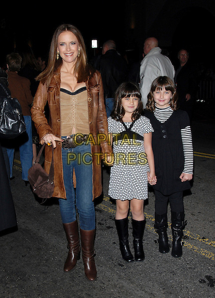 "KELLY PRESTON & CHILDREN.attends The Touchstone Pictures' World Premiere of ""Wild Hogs"" held at The El Capitan Theatre in Hollywood, California, USA, February 27 2007. .full length mother daughters brown coat boots jeans black and white dresses holding hands family.CAP/DVS.©Debbie VanStory/Capital Pictures"