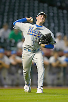 Trevor Bauer #11 of the UCLA Bruins makes a throw to first base versus the Rice Owls  in the 2009 Houston College Classic at Minute Maid Park February 27, 2009 in Houston, TX.  The Owls defeated the Bruins 5-4 in 10 innings. (Photo by Brian Westerholt / Four Seam Images)