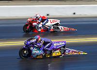Jul 31, 2016; Sonoma, CA, USA; NHRA pro stock motorcycle rider L.E. Tangled (near) races alongside Hector Arana Sr during the Sonoma Nationals at Sonoma Raceway. Mandatory Credit: Mark J. Rebilas-USA TODAY Sports