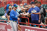 Hartford Yard Goats shortstop Brendan Rodgers (2) signs autographs before a game against the Erie SeaWolves on August 6, 2017 at UPMC Park in Erie, Pennsylvania.  Erie defeated Hartford 9-5.  (Mike Janes/Four Seam Images)
