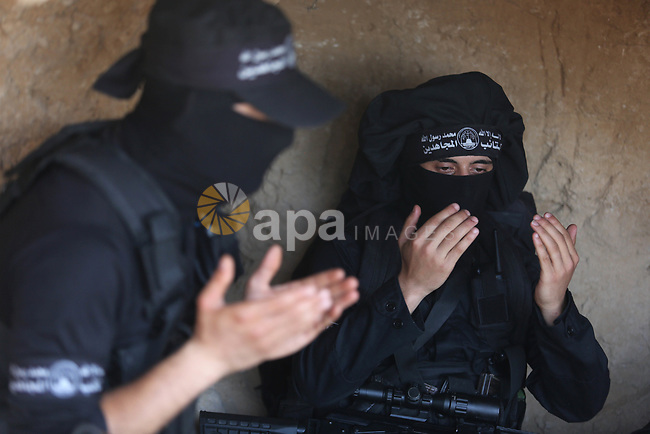 Palestinian militants pray at the tunnel in the east of Gaza city on the Muslim holy fasting month of Ramadan on May 24, 2018. Ramadan is sacred to Muslims because it is during that month that tradition says the Koran was revealed to the Prophet Mohammed. The fast is one of the five main religious obligations under Islam. More than 1.5 billion Muslims around the world will mark the month, during which believers abstain from eating, drinking, smoking and having sex from dawn until sunset. Photo by Ashraf Amra