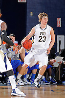 12 January 2012:  FIU guard Tanner Wozniak (23) handles the ball in the first half as the Middle Tennessee State University Blue Raiders defeated the FIU Golden Panthers, 70-59, at the U.S. Century Bank Arena in Miami, Florida.