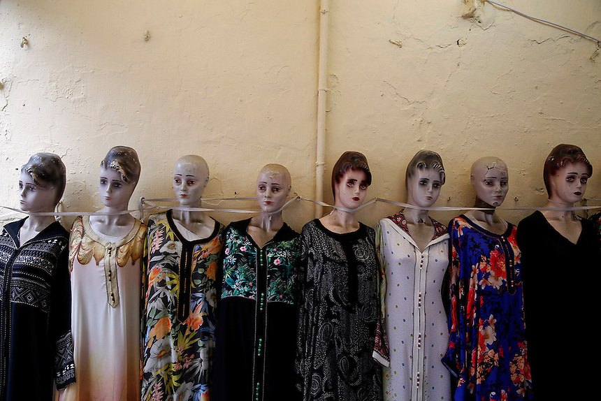 "Mannequins with ladies clothes for sale are lined against the wall in Rabat's Medina September 21, 2014. Behind walls of Medina and Kasbah of the Oudayas, ancient neighbourhoods of Morocco's capital, labyrinths of small alleys, colourful buildings and street markets offer a glimpse into city's rich history. Rabat was recently listed by UNESCO as a World Heritage Site and suggested as a ""must see"" destination by major media outlets and tourist agencies.  REUTERS/Damir Sagolj (MOROCCO)"