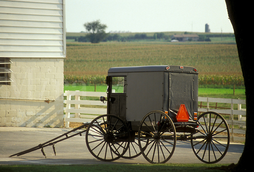 AJ3016, amish, buggy, amish country, Lancaster County, Pennsylvania, Pennsylvania Dutch Country, An Amish covered buggy is parked outside an Amish farm in Lancaster in the state of Pennsylvania.