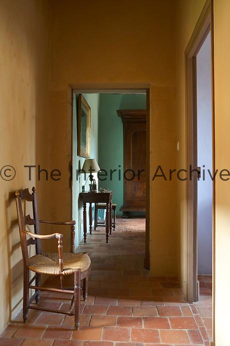 View through open door from yellow hallway into room beyond, Chateau de la Bourlie, Dordogne