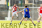 Tadhg Morley Kenmare in action against Eoin Lawlor Rathmore in the Senior County Football Semi Final in Fitzgerald Stadium on Sunday.