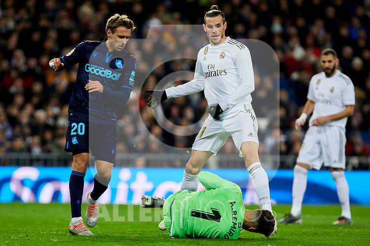 Gareth Bale of Real Madrid and Nacho Monreal (L) and Alex Ramiro (R) of Real Sociedad during La Liga match between Real Madrid and Real Sociedad at Santiago Bernabeu Stadium in Madrid, Spain. November 23, 2019. (ALTERPHOTOS/A. Perez Meca)