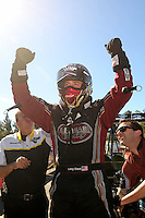 Nov 14, 2010; Pomona, CA, USA; NHRA top fuel dragster driver Larry Dixon celebrates after winning in the first round and clinching the 2010 top fuel championship during the Auto Club Finals at Auto Club Raceway at Pomona. Mandatory Credit: Mark J. Rebilas-