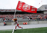 Brutus runs with a flag showing all eight national championship years during the celebration for winning the most recent national championship at Ohio Stadium on Jan. 24, 2015. (Adam Cairns / The Columbus Dispatch)
