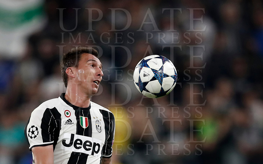 Football Soccer: UEFA Champions UEFA Champions League quarter final first leg Juventus-Barcellona, Juventus stadium, Turin, Italy, April 11, 2017. <br /> Juventus Mario Mandzukic in action during the Uefa Champions League football match between Juventus and Barcelona at the Juventus stadium, on April 11 ,2017.<br /> UPDATE IMAGES PRESS/Isabella Bonotto