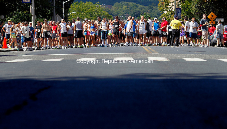 Waterbury, CT-09 September 2012-090912CM03-  Runners line up before the start of the 7th annual Bob Veillette 5k fundraising race Sunday morning in Waterbury.  Veillette, a longtime managing editor of the Republican-American, was paralyzed several years ago by a stroke.  Alen Wells of Orlando, FL was the overall winner.  Christopher Massa Republican-American