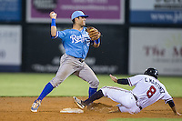 Gabriel Cancel (12) of the Burlington Royals turns a double play as Carlos Martinez (8) of the Danville Braves slides into second base at American Legion Post 325 Field on August 16, 2016 in Danville, Virginia.  The game was suspended due to a power outage with the Royals leading the Braves 4-1.  (Brian Westerholt/Four Seam Images)