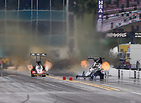 Mar 14, 2015; Gainesville, FL, USA; NHRA top fuel dragster driver Larry Dixon (right) races alongside Doug Kalitta as he crashes after his car broke in half during qualifying for the Gatornationals at Auto Plus Raceway at Gainesville. Dixon walked away from the incident. Mandatory Credit: Mark J. Rebilas-USA TODAY Sports