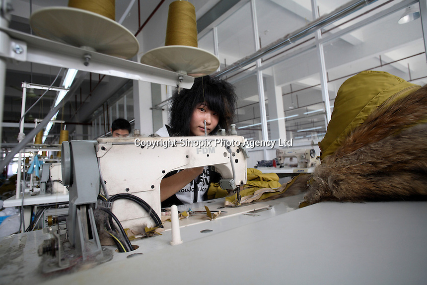 Workers sow down jackets together at the Quanli Garment Factory in Pinghu, Zhejiang Province, China..