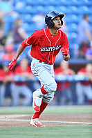 Lakewood BlueClaws second baseman Daniel Brito (21) runs to first base during a game against the Asheville Tourists at McCormick Field on June 2, 2017 in Asheville, North Carolina. The Tourists defeated the BlueClaws 7-5. (Tony Farlow/Four Seam Images)