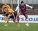 Arbroath's Dylan Carreiro gets past Annan's Ryan McStay.