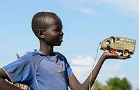 ETHIOPIA Gambela, Nuer village, toy car made from US AID oil can / AETHIOPIEN, Gambela, Region Itang, Dorf Pilual der Ethnie NUER, Junge Bhan mit selbst gebasteltem Blechauto aus USAID Oeldose