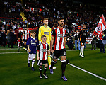 Jake Wright of Sheffield Utd leads the teams out makes his hime debut during the Carabao Cup, second round match at Bramall Lane, Sheffield. Picture date 22nd August 2017. Picture credit should read: Simon Bellis/Sportimage