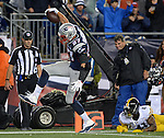 New England Patriots tight end Rob Gronkowski, left, dances his way into the end zone past past Pittsburgh Steelers defensive back Antwon Blake during the second quarter of the Patriots' home opener at Gillette Stadium in Foxboro on Thursday, September 10, 2015. Photo by Christopher Evans