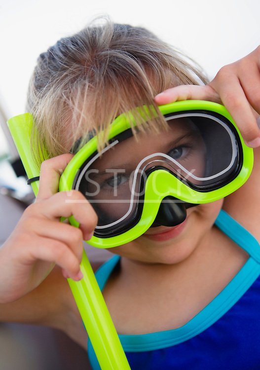 Young girl (6-8) wearing snorkeling mask, portrait