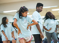 NWA Democrat-Gazette/BEN GOFF @NWABENGOFF<br /> Olivia NeSmith and JaQuan Farr, students in the Dance 4 class, rehearse Thursday, Sept. 6, 2018, for an upcoming performance at Rogers High School. The school's dance classes are working on routines for the Back to School Kermes latin food festival, from 12:00 p.m. to 4:00 p.m. Sunday in the school's courtyard. The public event is a fundraiser for the school's dance program.