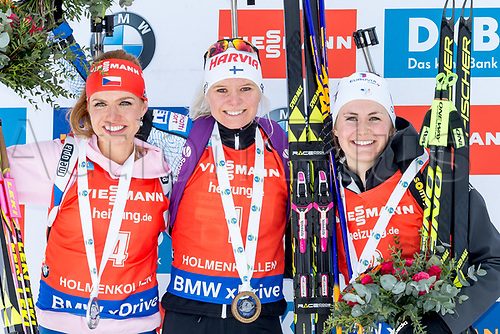 March 18th 2017, Oslo, Norway; BMW IBU World Cup Biathlon;  L-R  Gabriela Koukalova of Czech Republic, Mari Laukkanen of Finland and  Justine Braisaz of France celebrate on the podium during women 10km pursuit at the IBU World Cup Biathlon in Holmenkollen Oslo, Norway