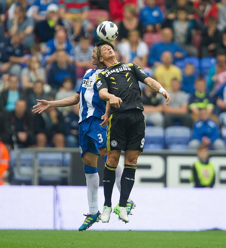 Chelsea's Fernando Torres and Wigan Athletic's Antolin Alcaraz ..Football - Barclays Premiership - Wigan Athletic v Chelsea - Sunday 19th August 2012 - DW Stadium - Wigan..