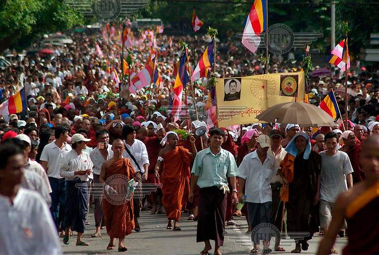 Thousands join a protest march led by Buddhist monks calling for the overthrow of the country's military junta.