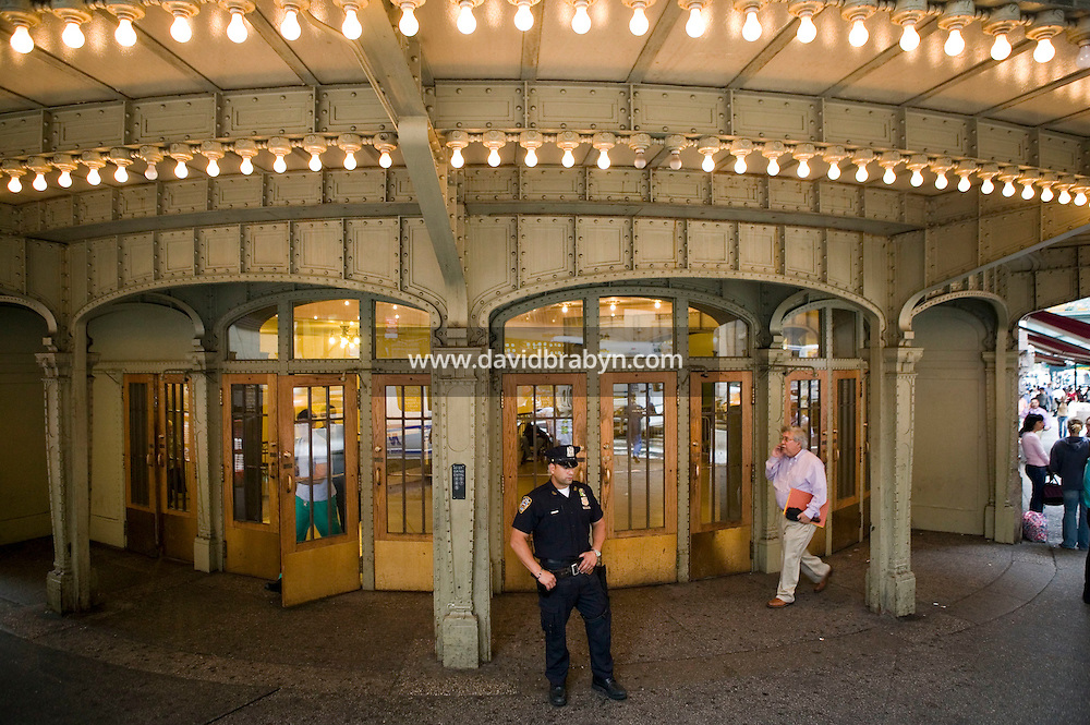 7 October 2005 - New York City, NY - New York City police officer Martinez (first name withheld, 2L) stands guard at the entrance to Grand Central Station in New York City, on 7 October 2005, the day after the Police Department announced a specific terrorist threat to the subway system had been identified. Photo Credit: David Brabyn.