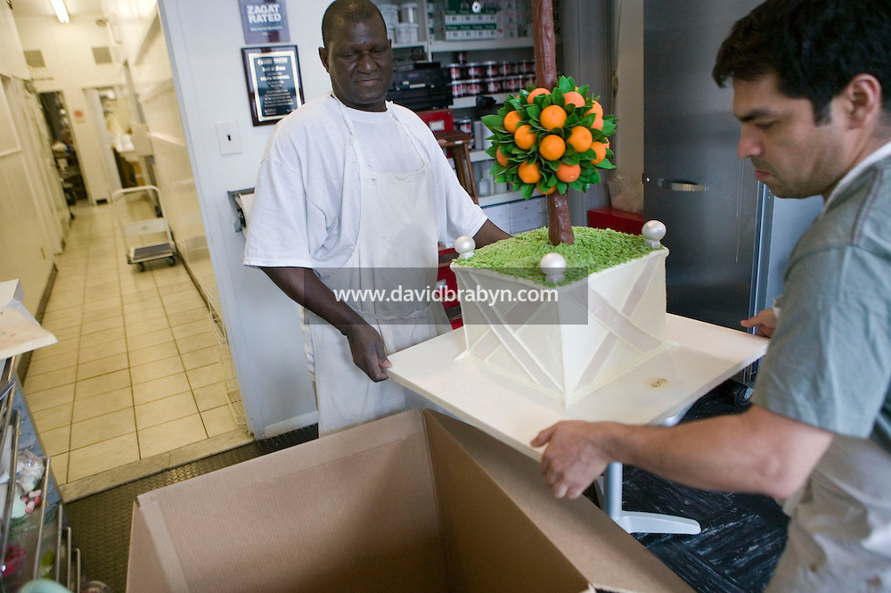 6 April 2006 - New York City, NY - Workers place a giant cake topiary in a box for shipping at Sylvia Weinstock Cakes in New York City, USA, 6 April 2006. The owner, Sylvia Weinstock is known as the queen of wedding cakes in New York.