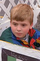 Thoughtful boy age 8 at Cinco de Mayo Festival.  St Paul  Minnesota USA