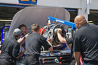 The Aaron's Lucky Dog Toyota crew installs a new engine prior to the Nascar Craftsman Truck Series O'Reilly Auto Parts 250 at Kansas Speedway in Kansas City, Kansas on April 28, 2007.
