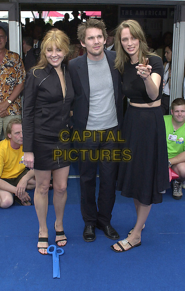 "NATHASHA RICHARDSON, ETHAN HAWKE, UMA THURMAN.Photocall for film ""Chelsea Walls"".Cannes Film Festival, France.May11th 2001..full length ex celebrity couple pointing .Ref: PL.www.capitalpictures.com.sales@capitalpictures.com.©Capital Pictures."