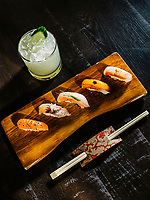 From left to right, nigiri dishes including Masu (Tasmanian Ocean Trout, Tobiuo (Flying Fish), Kinmedai (Golden eye Snapper), Inada (Baby Yellowtail) and Kurudai (Black Bream) at Uchi Restaurant in Denver, Colorado, Monday, March 25, 2019. The drink is a Fiery Yu.<br /> <br /> Photo by Matt Nager