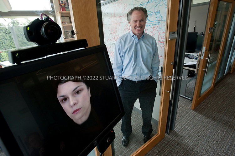 6/16/2010--Redmond, WA, USA..Eric Horvitz, Distinguished Scientist at Microsoft Research, shown here with his Personal Assistant, 'Diane', which works with visitors and colleagues outside his office.  Like the Bayesian Medical Kiosk, the research prototype understands how to engage in a conversation with one or more people, the etiquette of taking turns, means for handling barge-ins and interruptions, and when people are speaking to it versus to one another. . .The Personal Assistant has access to a Horvitz's calendar, his current location, activities on any computer he has been using, as well as an open microphone in Eric's office used to determine if he is currently engaged in a conversation.  The Personal Assistant uses this data, along with predictive models constructed from an 8-year old database of Eric's comings and goings to gain the insights of an expert assistant with regards to where Eric is and when he will return, as well as his availability for appointments...©2010 Stuart Isett. All rights reserved.