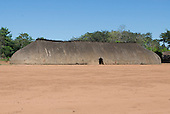 Xingu Indigenous Park, Mato Grosso State, Brazil. Aldeia Waura. Very long traditional oca house.