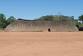 Xingu Indigenous Park, Mato Grosso State, Brazil. Aldeia Waura. Very long traditional oca house.