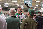 The OU hockey team shakes hands with 1960s hockey alumni after the first period of the OU vs. Kent State game on September 30, 2016.