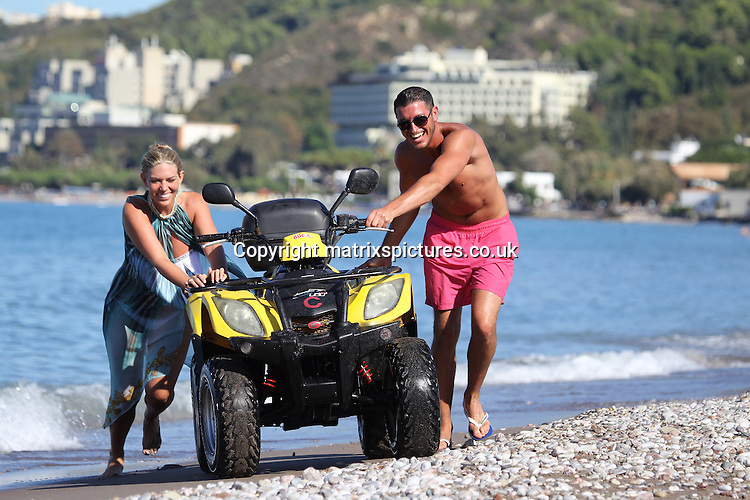 EXCLUSIVE PICTURE: TREVOR ADAMS / MATRIXPICTURES.CO.UK<br /> PLEASE CREDIT ALL USES<br /> <br /> WORLD RIGHTS<br /> <br /> English TOWIE reality TV star Frankie Essex is spotted flaunting her curvier figure in a sexy two-piece tasseled bikini, while on holiday in Greece with her boyfriend John Lyons.<br /> <br /> The loved-up couple have fun on a quad bike at the beach. <br /> <br /> The pair split in February earlier this year following a 7 month romance, but reunited at the end of July. While her co-stars appear unlucky in love, Frankie seems happier than ever! <br /> <br /> Previously unhappy with her fluctuating weight, she now seems to be embracing her curves, as her does her lucky boyfriend!<br /> <br /> OCTOBER 2nd 2013<br /> <br /> REF: UPR 136513