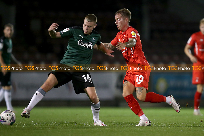 Jordan Maguire-Drew of Leyton Orient and Lewis Macleod of Plymouth Argyle during Leyton Orient vs Plymouth Argyle, Caraboa Cup Football at The Breyer Group Stadium on 15th September 2020