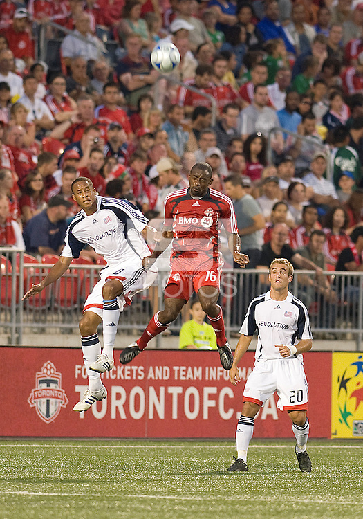 Marvell Wynne (16) of Toronto FC battles with Chris Tierney (8) of the New England Revolution. The game ended in a 1-1 draw.