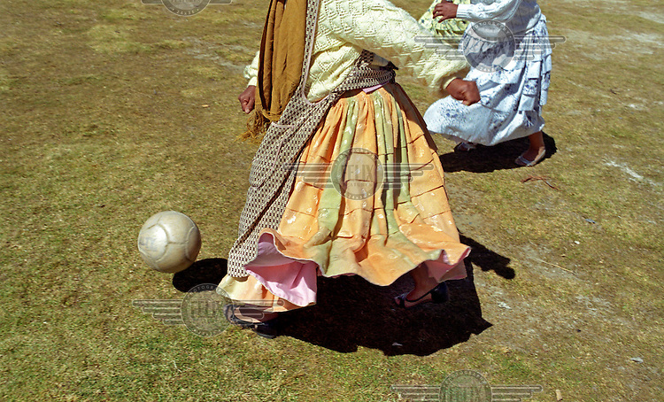 Cholitas, indigenous Bolivian women, play a game of football in the village of Huarina which is 4100 metres above sea level. Every Sunday, cholitas from the villages on the Altiplano come together to play football for fun and sometimes organise local championships.
