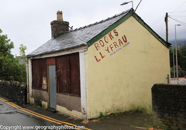 Closed boarded up bookshop, Blaenau Ffestiniog, Gwynedd, north Wales, UK
