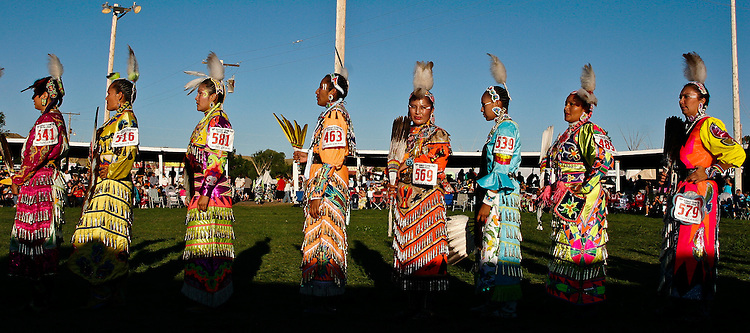 Jingle dress dancers gather for the judges after their songs.