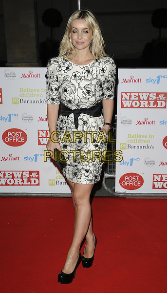 LOUISE REDKNAPP .At the Children's Champions Awards 2010, Grosvenor House Hotel, Park Lane, London, England, UK, .March 3rd 2010..arrivals full length cream white flower floral print patterned pattern black dress waistband waist belt hand in pocket clutch bag shoes platform clutch bag .CAP/CAN.©Can Nguyen/Capital Pictures.