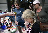 NWA Democrat-Gazette/CHARLIE KAIJO Ava Vanston, 9, of Rogers samples a Cucamelon or Mexican sour gherkin (a type of cucumber), Sunday, October 7, 2018 at Hobbs State Park in Rogers.<br />