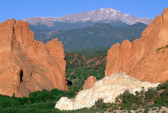 Pikes Peak framed by Gateway Rocks sandstone formation in Garden of the Gods park, near Colorado Springs, CO