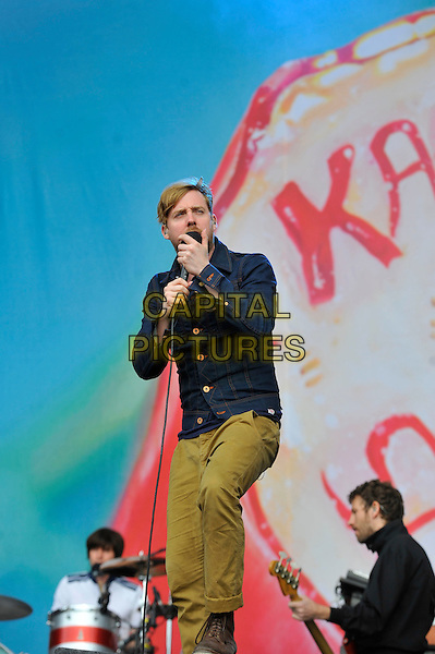 Ricky Wilson of Kaiser Chiefs.performing on Day 3 at Reading Festival, Reading, England. .26th August 2012.on stage in concert live gig performance performing music full length blue  jacket khaki trousers singing beard facial hair .CAP/MAR.© Martin Harris/Capital Pictures.