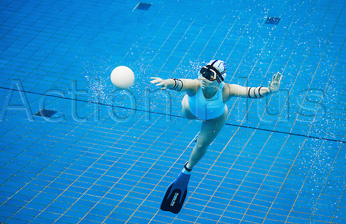 29.07.2015. Berlin, Germany.  A woman tries to reach the ball as she plays underwater rugby in the public swimming pool at the Olympic stadium in Berlin, Germany. The players try to score by placing the ball that is filled with salt water into the basket of the opposing team.